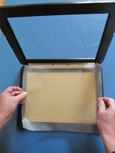 Placing the sheet on the drawing surface