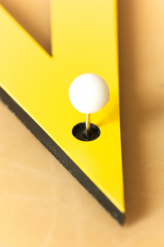 Marked holes are used to fix the drawing tools with pins